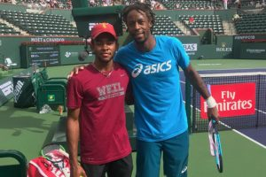Top 10 ATP tennis pro Gael Monfils from France on court with Weil Tennis Academy training partner. All the Top WTA and ATP pros hit with Weil Academy tennis players to warm up properly for all their big matches at the Larry Ellison owned BNP Paribas Open at Indian Wells CA USA every year.