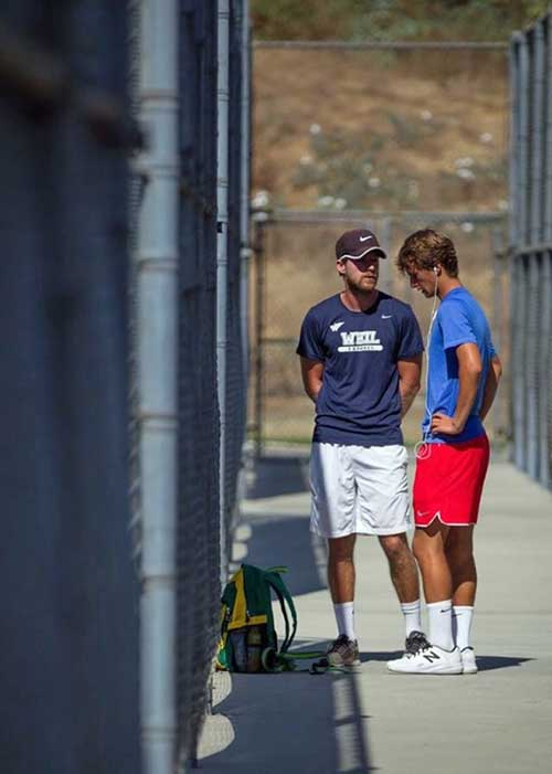Weil Coaches travel with tennis campers and help them prepare for each match as pictured here as Weil Coach and top ranked junior tennis player talk strategy before his Southern California ITA match.