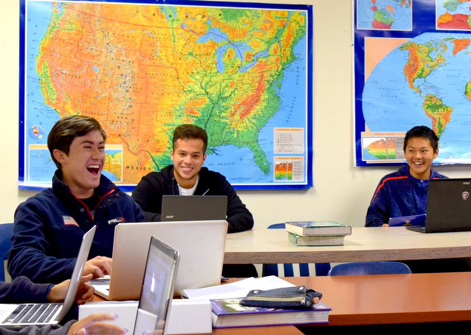 Weil Academy student athletes enjoy a laugh in the classroom.  Weil boarding school is a private, college preparatory school in Ojai CA near Los Angeles and San Diego.