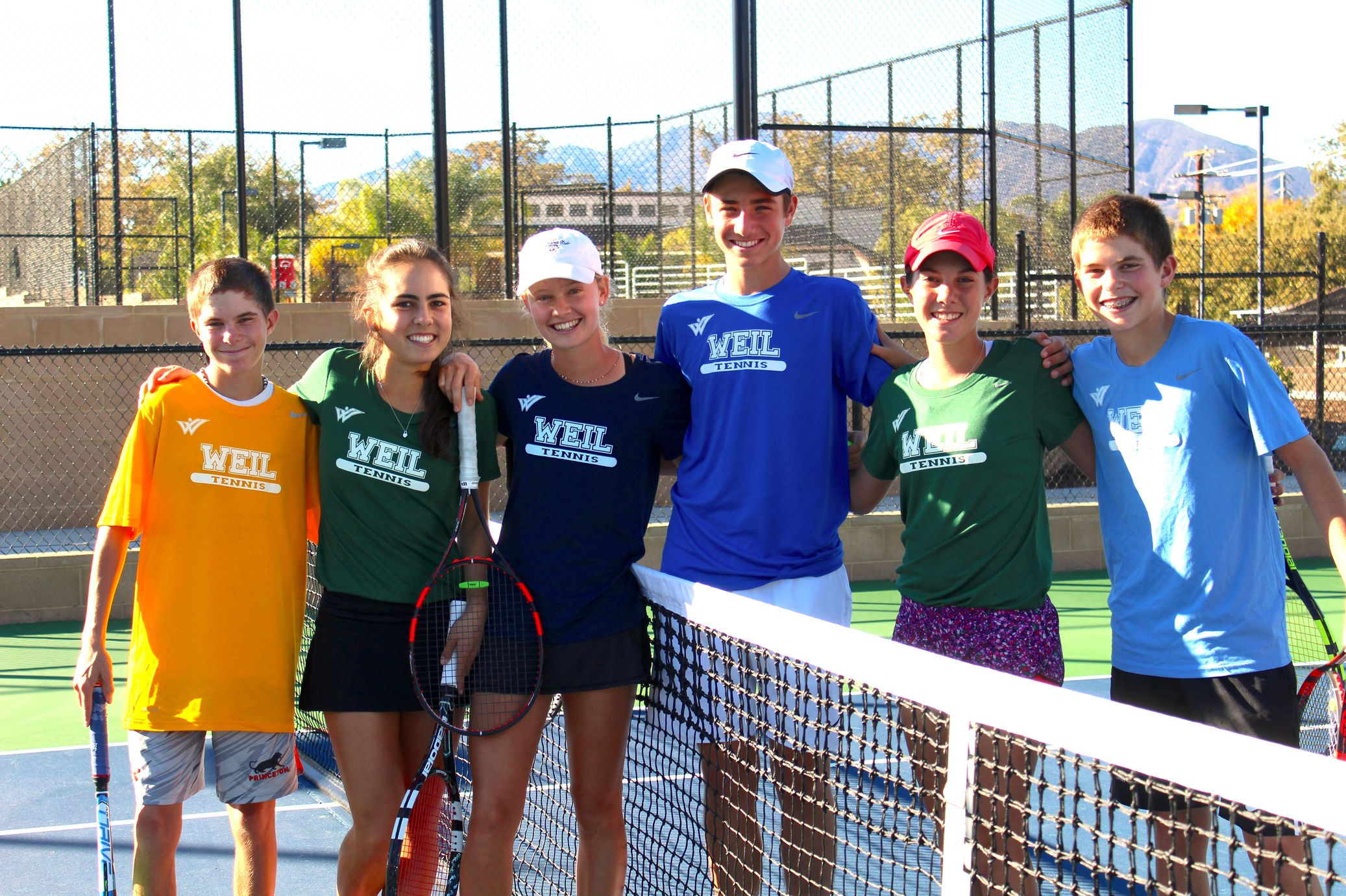Weil Academy student athletes enjoy the Southern California lifestyle on and off the court, they become friends and learn to compete as members of the same team as they travel to tourna-ments every weekend. Here five Weil students from three states Mexico and Brazil have fun on the tennis courts in Ojai CA at Weil Academy near Los Angeles and San Diego.